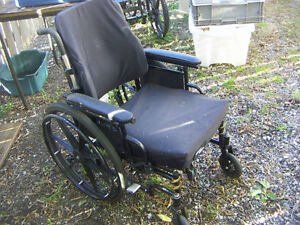 Wheelchair [not fold-up] nice cushion, no feet, $35.00