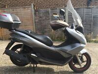 2014 Honda PCX 125cc scooter learner legal 125 cc. MOT 2 years.
