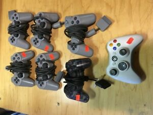 7 SONY PLAYSTATION CONTROLLERS