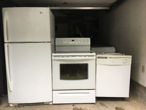 4 PC white fridge and stove and dishwasher and microwave for sal