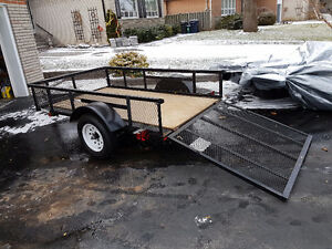 Utility trailer and ramp gate