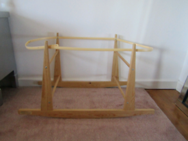 Off white moses basket with a rocking stand