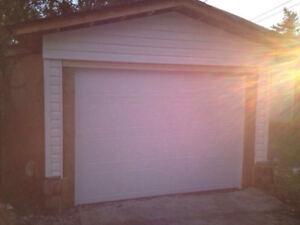 USED GARAGE DOORS- NEW HARDWARE
