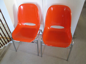 six Mid Century Orange plastic & chrome frame stacking chairs