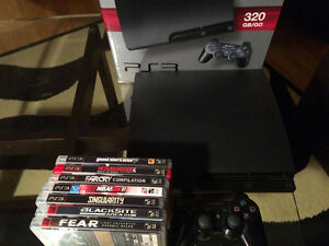 Console PS3 avec 7 jeux et manette