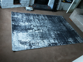 Black Distressed Rug. In good condition.