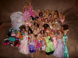 Huge lot of barbie dolls with clothes and accessories