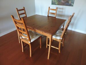 IKEA wood dining room table and 4 matching chairs