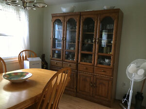 Dining room table and 6 chairs and 4 large cabinets