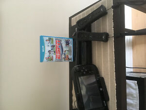 USED ONCE - Wii U console with extra remote and sports game