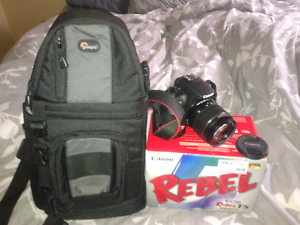 Camera EOS Rebel T5 and hiking backpack for the camera