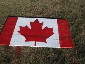 About 21 inches by 40 inches wood strip Canadian Flag. Only $35.