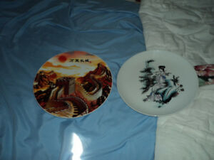 I have 14 Chinese Collectible Plates and two Vases for sale