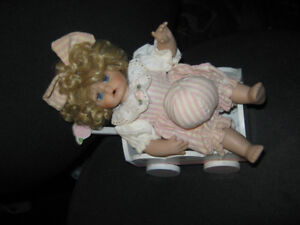 porcelain doll with wagon and ball