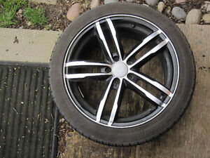 Four 17 inch rims and tires 5X100 pattern 40 offset