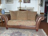 3 piece suite, sofa and 2 chairs, half leather cottage in a cottage style.