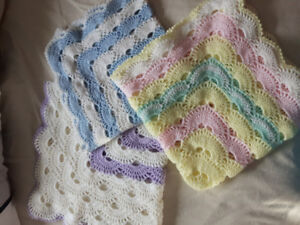 Crochet baby recieving blanket and knitted baby layette set