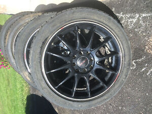 "4 ""Street Gear"" wheels and tires 205 45 16"