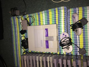 Super Nintendo with 2 controllers and 27 games