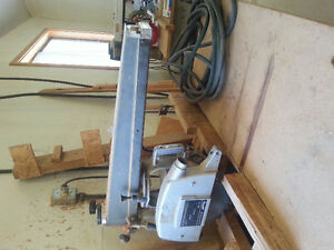 "10"" Dewalt Radial Arm Saw Mounted on Table"