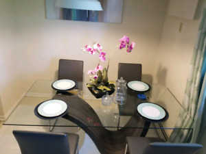 Beautiful 6 piece glass dining table set