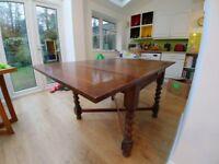 Wooden Oak draw leaf table