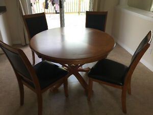 A dining table with four chairs
