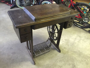 Vintage treadle sewing machine with cabinet