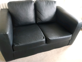 Two faux black leather setties