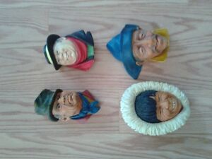 "4 Bosson ""head figurines"""