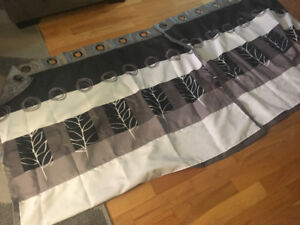 Two curtain panels. Beautiful hand made. Grey black and white