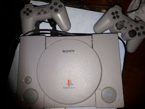"""PlayStation with 15 games & 19"""" flat screen tv"""