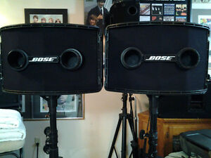 Two BOSE 802 speakers with stage stands