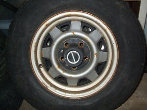 four Ford rims 14 inch
