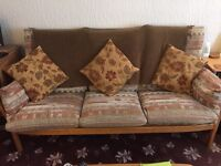 Ercol wooden framed sofa and armchairs.