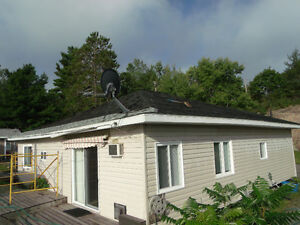 PROPERTY INCLUDES 3 SEASONAL COTTAGES AS IS  FOR SALE