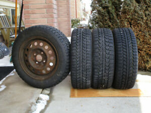 4 snow tires on rims  - P195/60R15 88S Tiger Paw Ice and Snow II