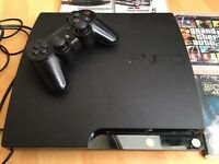 PlayStation 3 black with 6 games slimline controller
