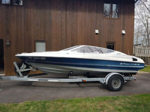 19 foot Bayliner Ciera and fitted travel trailer with cover