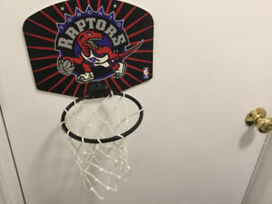 Raptors basket  ball board with net attached