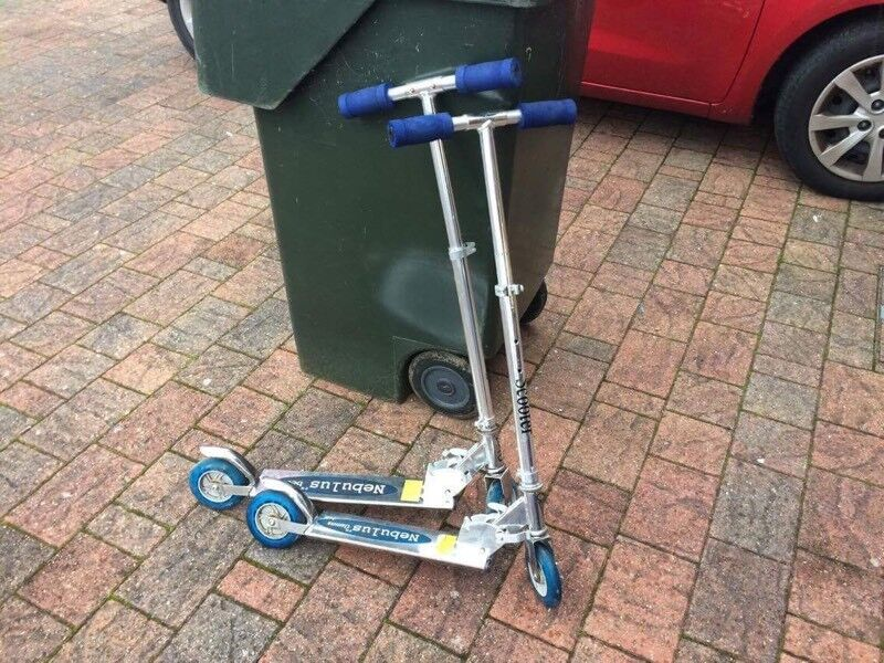 Two silver scooters