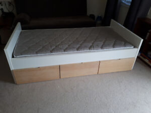 Twin bed with mattress, lots of storage space