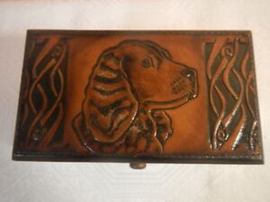 Wooden box with leather ornate
