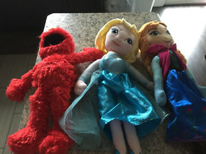 Tickle me Elmo and frozen talking dolls