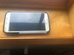 Unlocked Samsung S5 in good condition for sale with a free cover