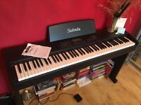 Sulinda electric piano / weighted keyboard with sustain pedal