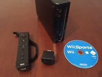 Boxed Nintendo Wii Black (rare) with Motion Plus, 9 games & WiiFit board