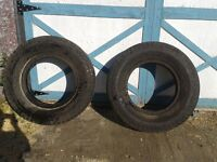 two 8.25 - 20 truck tires