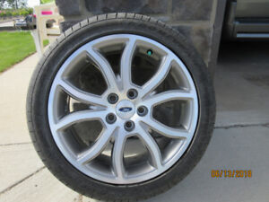 Four Ford tires and Rims