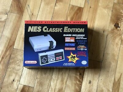 NINTENDO Presentation SYSTEM: NES CLASSIC EDITION MINI ( DISCONTINUED ) In hand